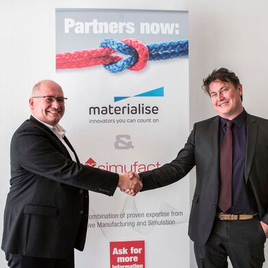 Handshake of the cooperation partners: Dr. Hendrik Schafstall (left), Managing Director & CTO Simufact Engineering, and Stefaan Motte (right), Vice President Software at Materialise.