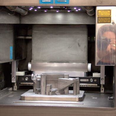 Renishaw uses the SLM powder bed process. It is the most common procedure